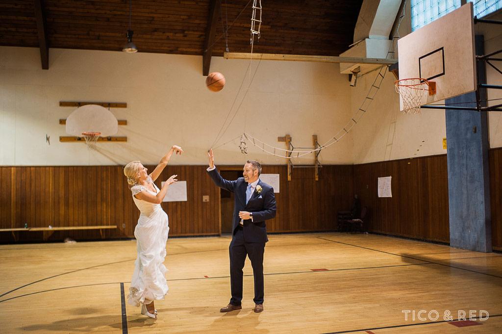 bride and groom play basketball